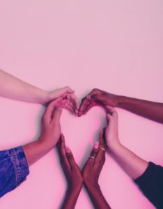 hands together making a shape of heart
